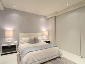 motorized shade in a master bedroom closed